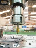 stock photo of machine  - operator machining mold and die parts for automotive by radius drilling machine - JPG