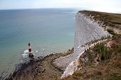 stock photo of cliffs  - Looking southwards down a cliff towards the lighthouse at the cliffs of Beachy Head - JPG