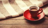 foto of orientation  - Red cup of the coffee and vintage scarf - JPG