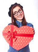 image of nerd glasses  - Nerd girl in glasses with heart shape gift - JPG