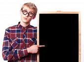 stock photo of nerd glasses  - Nerd guy in glasses with blackboard - JPG