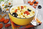 image of apricot  - Millet porridge with dried apricots and prunes in a bowl - JPG