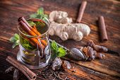 picture of cinnamon  - Hot tea with cinnamon and mint leafs - JPG
