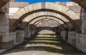 stock photo of empty tomb  - Interior of empty corridor with arcs - JPG