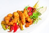 stock photo of ling  - Shrimp Fritter on dish in a crispy breading on vegetables with salad and sauce on a white plate - JPG