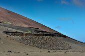 foto of volcanic  - wild volcanic landscape at Timanfaya National Park Lanzarote Island Canary Islands Spain - JPG