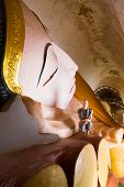 picture of recliner  - White tourist metitating by Huge Reclining Buddha Image at Manuha Pagoda - JPG