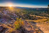 stock photo of sunrise  - Golden sunrise over Bandelier National Monument in New Mexico - JPG