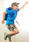 stock photo of leaping  - Portrait of a schoolchild with backpack leaping  - JPG