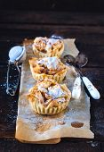 stock photo of pie-in-face  - Selective focus on the front baked mini apple pie - JPG