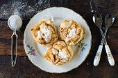 foto of pie-in-face  - Mini apple pies from above in the plate selective focus - JPG