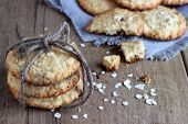 image of chocolate-chip  - oatmeal cookies on white linen napkin on wooden table - JPG