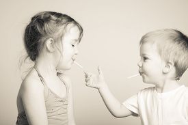 picture of  friends forever  - black and white photo of siblings playing with each other - JPG
