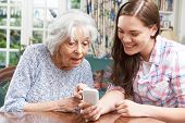 pic of granddaughters  - Teenage Granddaughter Showing Grandmother How To Use Mobile Phone - JPG