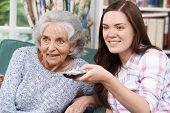 foto of granddaughters  - Teenage Granddaughter Watching Television With Her Grandmother - JPG