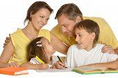 stock photo of homework  - Parents help children with homework on white background - JPG