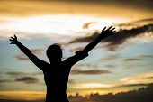 pic of open arms  - strong confidence woman open arms under the sunrise at seaside - JPG