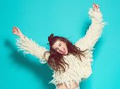 foto of crazy face  - studio portrait of cheerful fashion hipster girl going crazy making funny face and dancing - JPG
