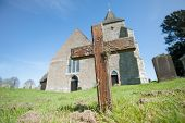 stock photo of graveyard  - old wooden cross in a church graveyard - JPG