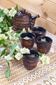 pic of teapot  - Teapot with small cups and jasmine flowers - JPG