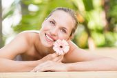 stock photo of day care center  - Attractive young woman getting massage on her back at spa center - JPG
