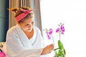 picture of nightie  - Lady wearing nightgown and flower arrangement in the morning - JPG
