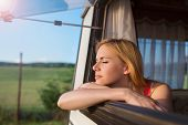 picture of campervan  - Beautiful young woman sitting in a camper van on a summer day - JPG