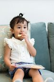 image of malaysian food  - Lovely girl having finger food at home - JPG