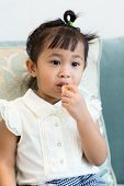 foto of malaysian food  - Cute girl having finger food at home - JPG