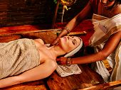 picture of ayurveda  - Woman having facial  ayurveda spa treatment - JPG