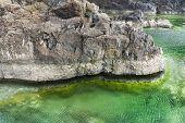 stock photo of volcanic  - Swimming natural pools of volcanic lava in Porto Moniz - JPG