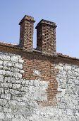 stock photo of chimney rock  - Two chimneys on old house Bulgaria Europe - JPG