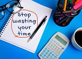 picture of waste management  - Stop wasting your time word on notebook - JPG