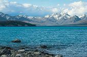 stock photo of incredible  - Beautiful incredibly blue lake Tekapo with  mountains - JPG
