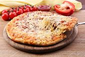 pic of cutting board  - Cheese pizza on wooden cutting board - JPG