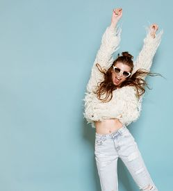 picture of crazy face  - studio portrait of cheerful fashion hipster girl going crazy making funny face and dancing - JPG