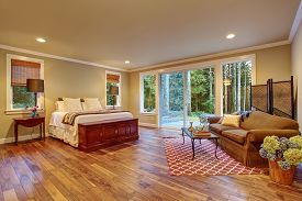 picture of master bedroom  - Large master bedroom with hardwood floor and sliding glass door to backyard - JPG