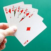stock photo of poker hand  - A perfect poker hand - JPG
