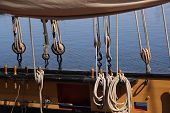 foto of pirate ship  - Detail of a wooden sailing ship rigging and ropes - JPG