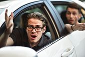 Accident. Young Caucasian Man Driving A Car Shocked About To Have Traffic Accident poster