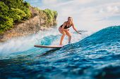 Attractive Surf Woman On Surfboard. Woman In Ocean During Surfing. poster