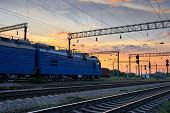 railroad infrastructure during beautiful sunset and colorful sky, trains and wagons, transportation  poster