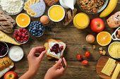 Female Hands Spreading Butter And Jam On Bread. Woman Cooking Breakfast. Healthy Breakfast Ingredien poster