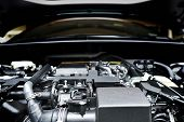 Close Up Of The Powerful Car Engine. Internal Design Of Engine. Automobile Metal New Car Engine Part poster