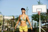 The Girl Basketball Player Have Training And Exercise At Basketball Court. Beautiful Young Woman Pla poster