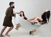 Relax Concept. Morning Relax In Bath. Bearded Man And Couple Of Women Relax In Bathroom. Relax And E poster