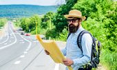 Carry Good Map. Tourist Backpacker Looks At Map Choosing Travel Destination At Road. Around The Worl poster