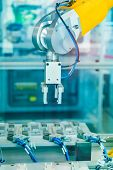 Robotic Arm production lines modern industrial technology. Automated production cell. poster