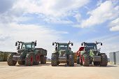 Agricultural Machinery. Three Heavy Industrial Tractors View, Standing In A Row poster