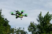 Green Race Drone Flying Trough The Air With Fpv For First Person View And Quadcopter Racing In Natur poster